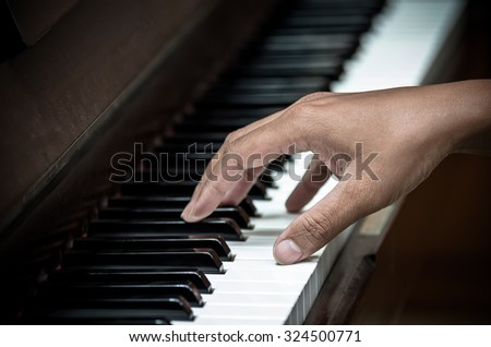 hands playing the piano,musical instrument