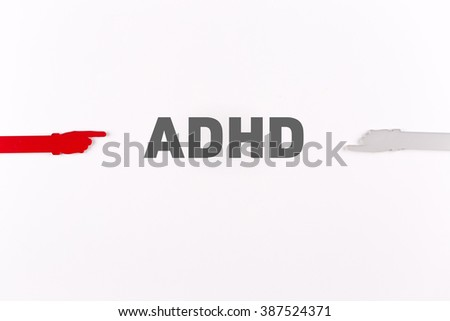 Hands pointing ADHD word - stock photo