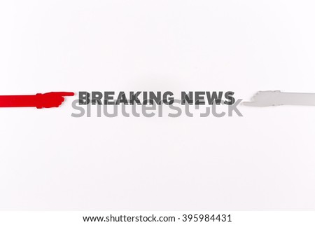 Hands pointing BREAKING NEWS word - stock photo