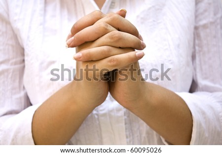Hands Positioned as in Prayer isolated on white - stock photo