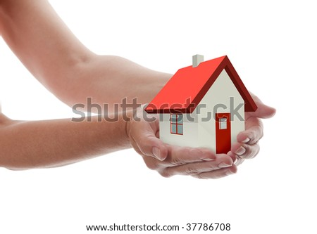 Hands presenting a tiny house towards you - stock photo