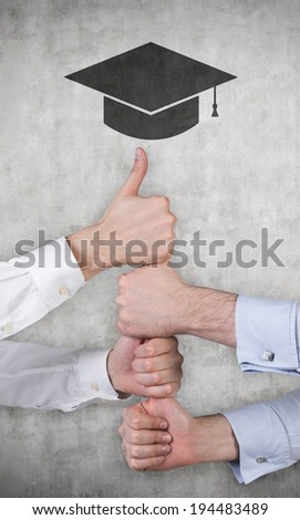 Hands, project work, graduation hat. Grey background. - stock photo