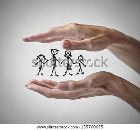 hands protecting a family - stock photo