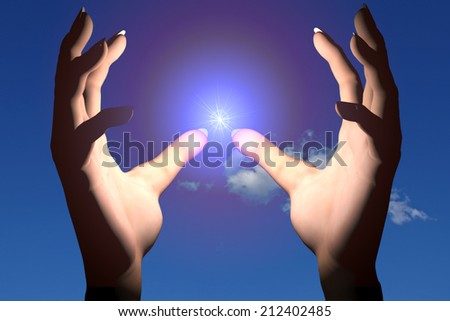 Hands protecting energy spark
