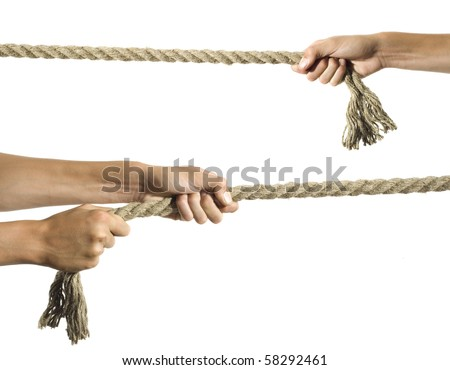 Hands pull a rope. Isolated white background - stock photo