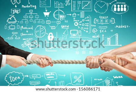 hands pulling rope, teamwork concept - stock photo