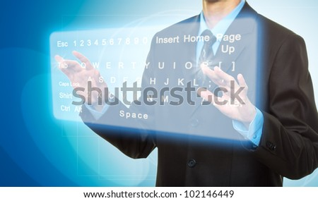 Hands pushing a button on a touch screen. Virtual Keyboard - stock photo