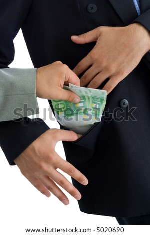 Hands putting bribe into a pocket. The receiver kindly accepts the donation.