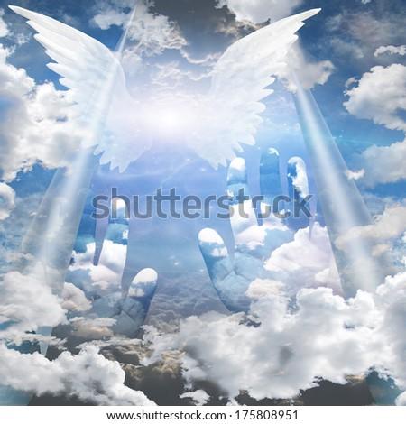 Hands reach up toward heaven - stock photo