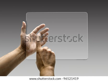 hands reaching images on a futuristic tablet - stock photo