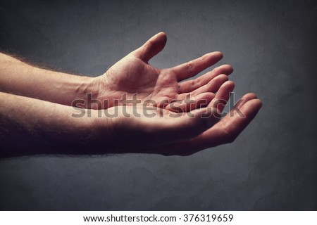 Hands reaching out concept for help, religion, salvation, forgiveness, assistance and love or begging - stock photo