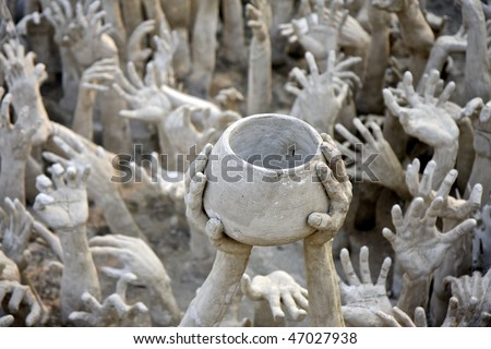 hands reaching out, sculpture at Wat Rong Khun, the white temple near Chiang Rai, Thailand - stock photo