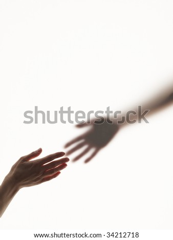 Hands reaching out to each other - stock photo