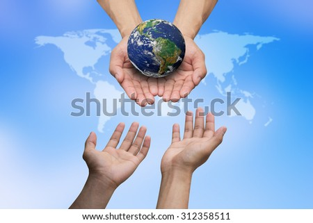 hands reaching the world for heal together, save the world concept ,Elements of this image furnished by NASA. - stock photo