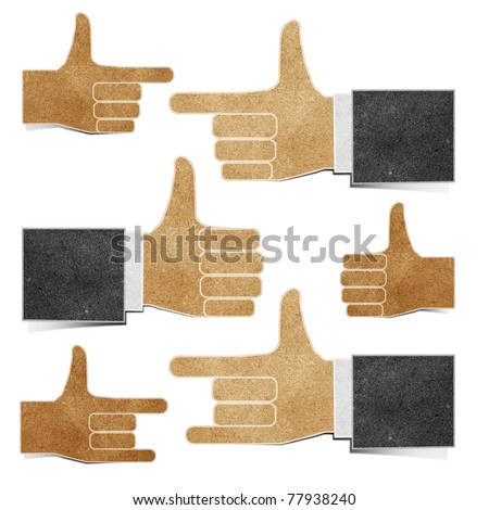 hands  recycled paper craft stick on paper background - stock photo