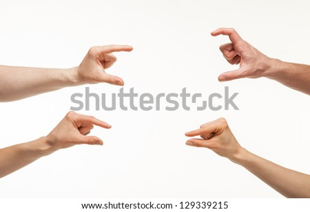 Hands showing different sizes - from small to big, white background - stock photo