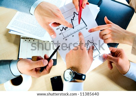 Hands showing the document at workplace