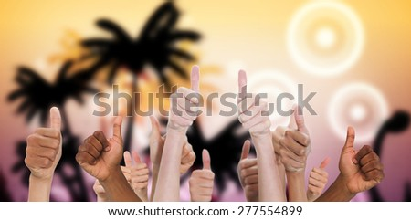 Hands showing thumbs up against digitally generated palm tree background - stock photo