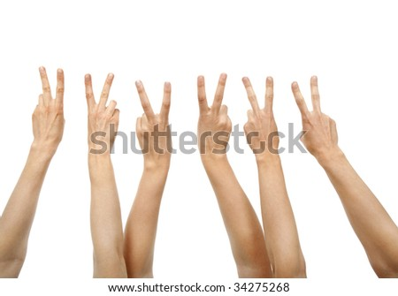 Hands showing victory sign, isolated on white. - stock photo