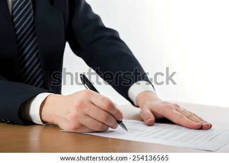Hands signing business documents. Signing papers. Lawyer, realtor, businessman sign documents.