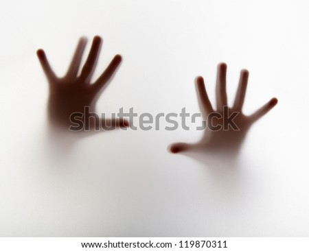 hands silhouette behind a  transparent  paper - stock photo