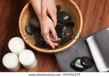 Hands spa, beautiful woman's hands in nail salon  - stock photo