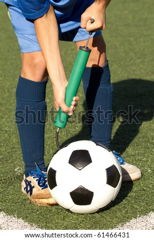 Hands  sportsman  ball  football  repair - stock photo