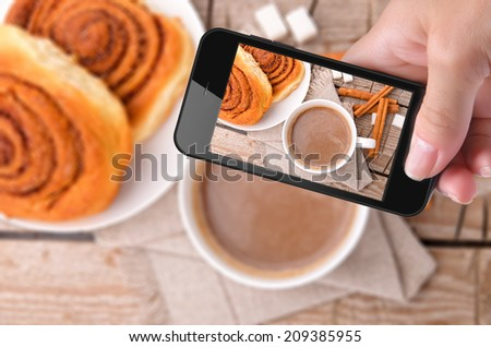 Hands taking photo cocoa with smartphone - stock photo