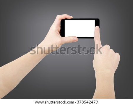 Hands taking photo on smartphone, empty screen, isolated on dark background, clipping path - stock photo