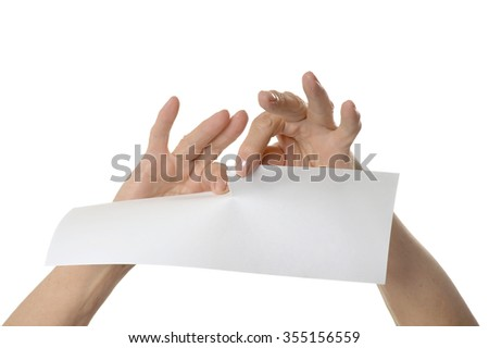 Hands tearing paper sheet, closeup on white background - stock photo