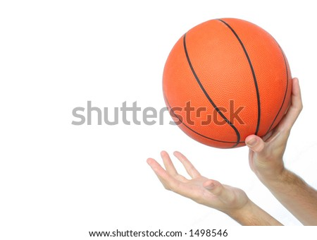 Hands throwing or catching a basketball ball isolated. - stock photo