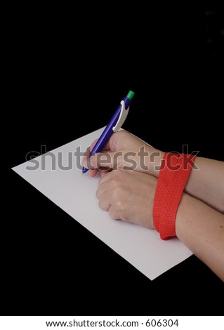 Hands tied by red tape - stock photo