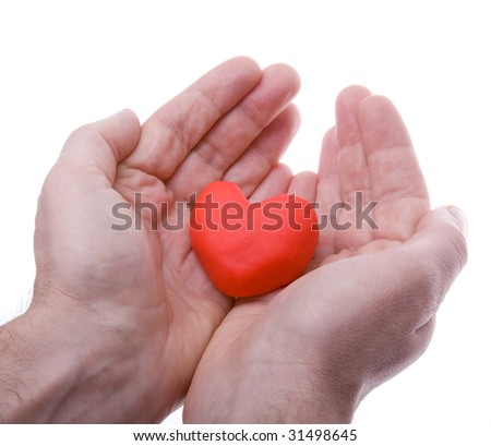 Hands tilting with heart - stock photo