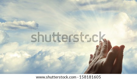 Hands together in the sky - stock photo