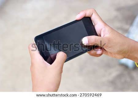hands touching smartphone bright background, closeup - stock photo