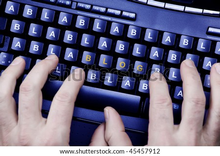 hands typing a blog bla bla bla - stock photo