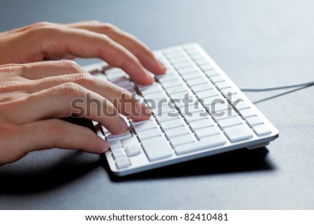Hands typing on a keyboard/ Typing on the keyboard - stock photo