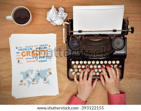 Hands typing on a Vintage typewriter. paper with business concept on table - stock photo