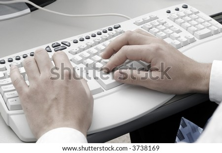 Hands typing on computer keyboard - stock photo