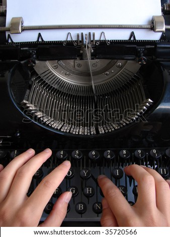 Hands typing on old typewriter - stock photo