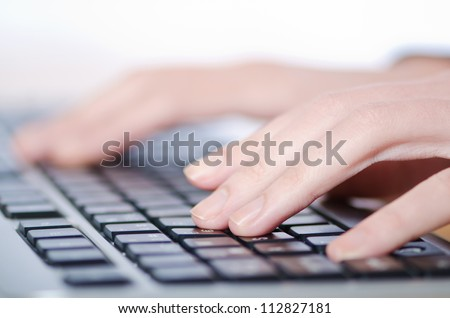 Hands typing on the keyboard - stock photo