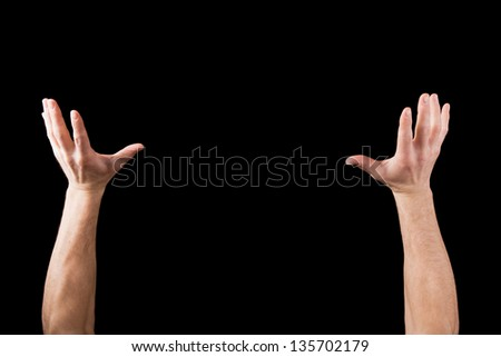 Hands up in the air like holding something isolated on black background - stock photo
