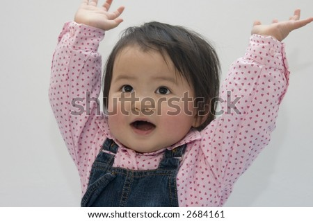 hands up little girl - stock photo
