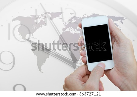 Hands using blank screen mobile smart phone with clock and world map background. World wide connection concept. - stock photo