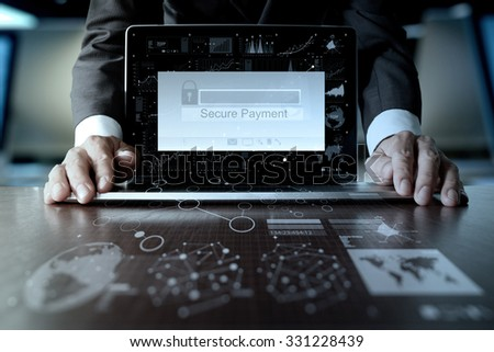 """hands using laptop and holding credit card with """"Secure payment"""" on the screen as Online shopping concept - stock photo"""