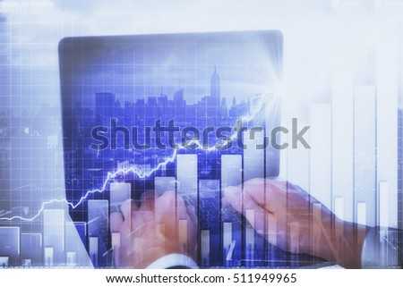 Hands using laptop with abstract business chart on city background. Fund management concept