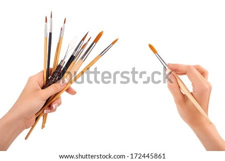 Hands with a brush isolated