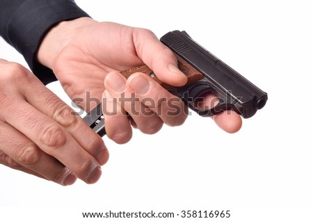 Hands with a handgun on a white background - stock photo