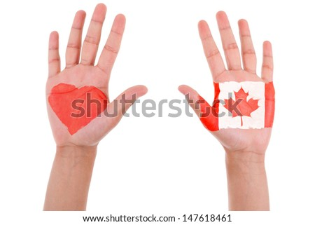 Hands with a painted heart and canadian flag, i love canada concept, isolated on white background - stock photo