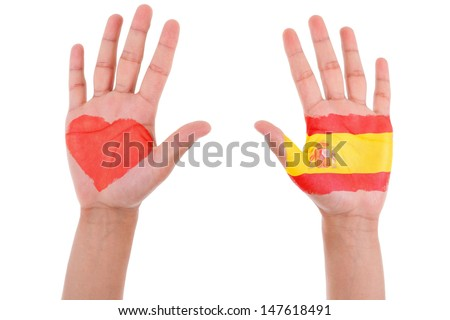 Hands with a painted heart and spanish flag, i love spain concept, isolated on white background - stock photo